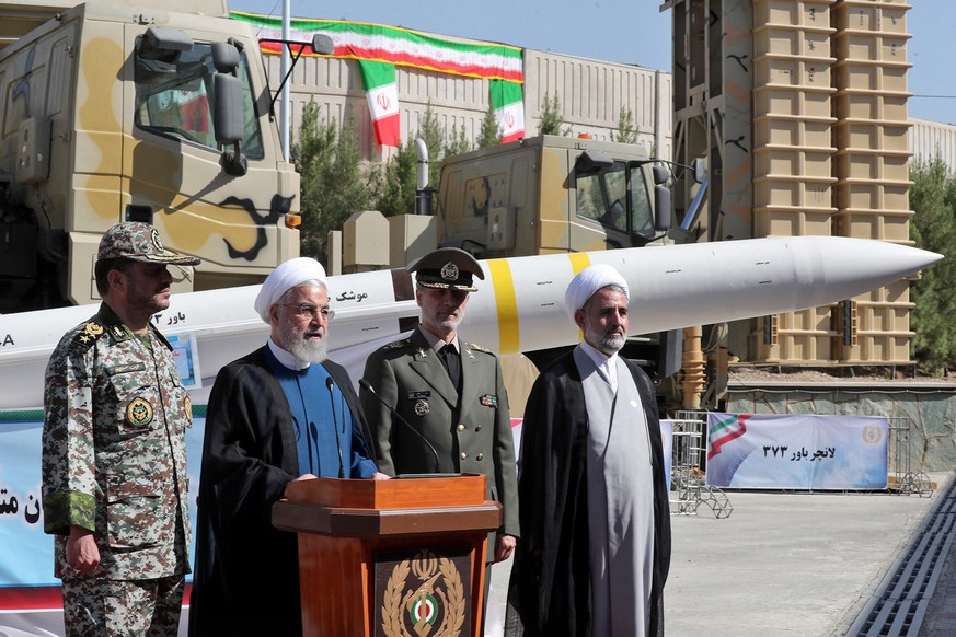 epa07785591 A handout picture made available by Iran's Presidential Office shows Iranian President Hassan Rouhani (2-L) delivering a speech next to Iranian Defense Minister Amir Hatami (2-R) during the inauguration ceremony of Iran's domestically built air defense missile system Bavar-373 (Believe), a long-range surface-to-air missile system, to mark Iran's National Defence Industry Day, in Tehran, Iran, 22 August 2019. Rouhani ordered the Bavar-373 missile defense system to be added to the country's network of air defense, media reported.  EPA/IRANIAN PRESIDENCY OFFICE HANDOU  HANDOUT EDITORIAL USE ONLY/NO SALES