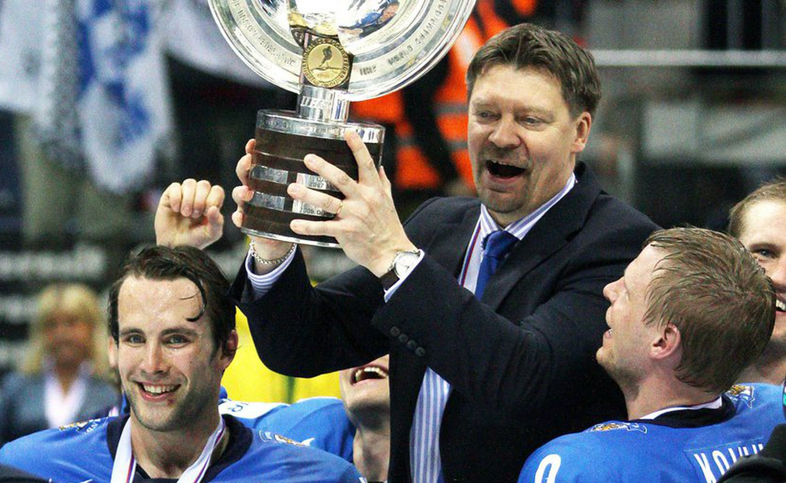 epa02735352 Players of Finland Tuomo Ruutu (L) and Mikko Koivu (R) lift their head coach Jukka Jalonen (C) with the trophy after they won the Ice Hockey World Championship final match between Sweden and Finland at the Orange Arena in Bratislava, Slovakia, 15 May 2011. Finland won 6-1.  EPA/PETER HUDEC