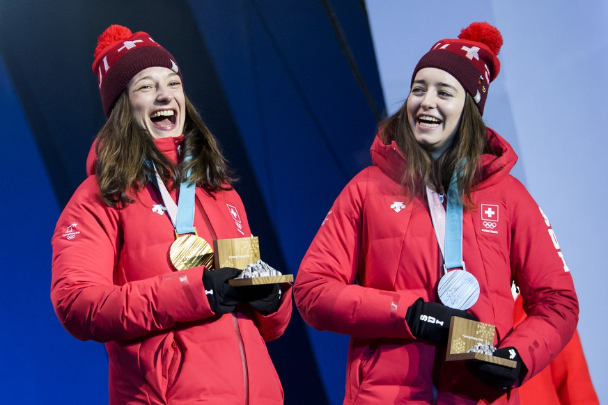 Gold medal winner Sarah Hoefflin of Switzerland, left, and Silver medal winner Mathilde Gremaud of Switzerland, right, celebrate during the victory ceremony on the Medal Plaza for the women Freestyle Skiing Slopestyle final at the XXIII Winter Olympics 2018 in Pyeongchang, South Korea, on Saturday, February 17, 2018. (KEYSTONE/Jean-Christophe Bott)