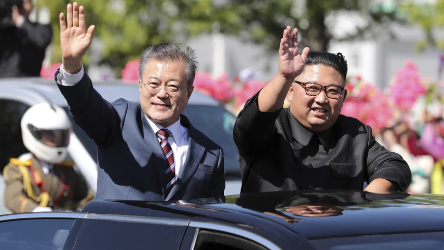FILE- In this Sept. 18, 2018 file photo, South Korean President Moon Jae-in, left, and North Korean leader Kim Jong Un ride in a car parade through Pyongyang in North Korea. Kim and Moon announced in the North Korean capital of Pyongyang this week that Kim has accepted Moon's request to visit Seoul soon, maybe within the year. (Pyongyang Press Corps Pool via AP, File)