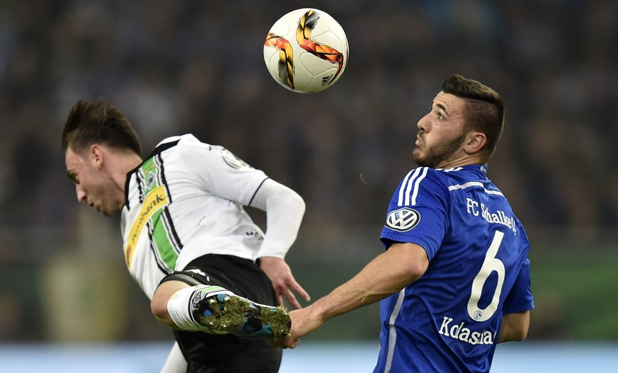 Schalke's Sead Kolasinac, right, and Moenchengladbach's Josip Drmic challenge for the ball during the German soccer cup second round match between FC Schalke 04 and Borussia Moenchengladbach  in Gelsenkirchen, Germany, Wednesday, Oct. 28, 2015. (AP Photo/Martin Meissner)