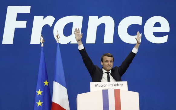 epaselect epa05924558 French presidential election candidate for the 'En Marche!' (Onwards!) political movement, Emmanuel Macron celebrates after the first round of the French presidential elections in Paris, France, 23 April 2017. Media reports that polling agencies projections place Le-Pen and centrist presidential candidate Emmanuel Macron in the lead positions for the vote. France will hold the second round of the presidential elections on 07 May 2017.  EPA/YOAN VALAT