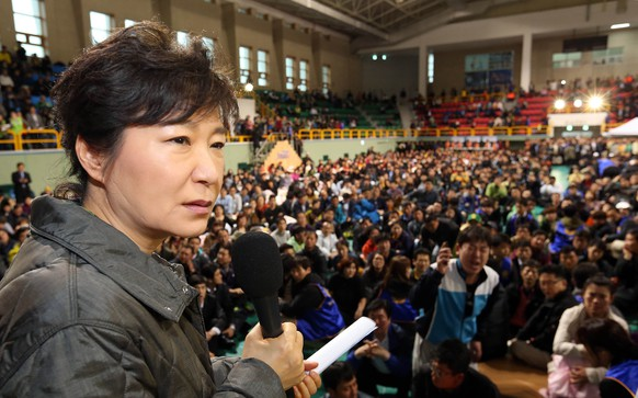 South Korean President Park Geun-hye speaks during a meeting with parents whose children are now missing in Ship Sewol at a gymnasium in Jindo, South Korea, Thursday, April 17, 2014. Fears rose Thursday for the fate of more than 280 passengers, many of them from a high school on a four-day trip, still missing more than 24 hours after their ferry flipped onto its side and filled with water off the southern coast of South Korea. (AP Photo/Yonhap, Do Kwang-hwan)   KOREA OUT