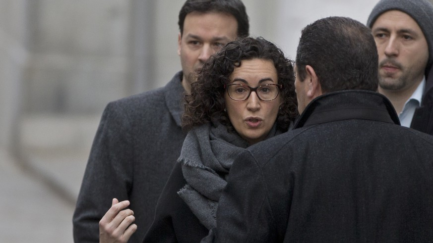 FILE - In this Feb. 19, 2018 file photo, Catalan separatist politician and left-republican ERC party's Marta Rovira arrives at the Supreme court for questioning in Madrid, Spain. Marta Rovira, a prominent Catalan separatist politician has defied a summons to appear in a Spanish court on Friday March 23, 2018 and says in a letter to her party followers that she has chosen
