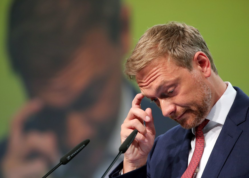 epa06730177 The leader of the Free Democratic Party (FDP), Christian Lindner, gestures during his speech in the FDP party conference in Berlin, Germany, 12 May 2018. Delegates will discuss and set the guidelines of the party´s program in themes such as work, education, civil rights and digitalisation. The congress, takes place from the 12 to 13 of May 2018.  EPA/FELIPE TRUEBA