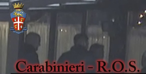 In this photo taken from a video provided by the Italian Carabinieri (paramilitary police), people identified by police as Italian cryme sindicate 'ndrangheta' members perform a ritual swearing-in ceremony. Police in northern Italy say for the first time they have video of a secret, ritual swearing-in ceremony for the 'ndrangheta', a powerful Italian crime syndicate. Their investigation also led to 40 arrests in a crackdown of extortion by mobsters preying on businesses in Lombardy and across the border in Switzerland. Milan Prosecutor Ilda Boccassini told reporters Tuesday the video of the ritual ceremony for recruits shows how the strength of the `ndrangheta `'is the force of tradition.