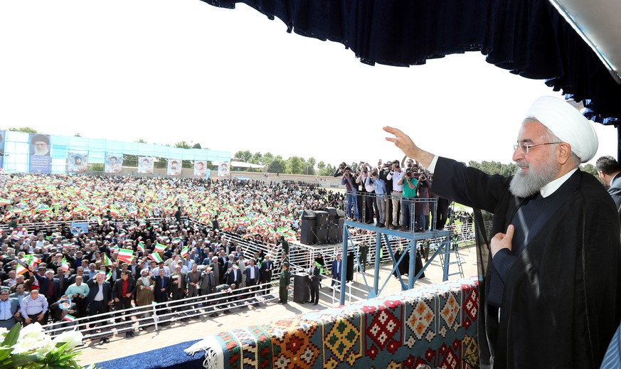 epa06714345 A handout photo made available by the Presidential office shows, Iranian President Hassan Rouhani greets the crowd in the city of Sabzevarr, northwestern Iran, 06 May 2018. Media reported that Rouhani said that for Iran EU countries reactions to US president Donald Trump's decision over Iran nuclear agreement more important than the decision of US president. He also added that if the US withdraw from the nuclear deal, they will be very regretful soon.  EPA/IRAN PRESIDENTIAL OFFICE / HANDOUT  HANDOUT EDITORIAL USE ONLY/NO SALES