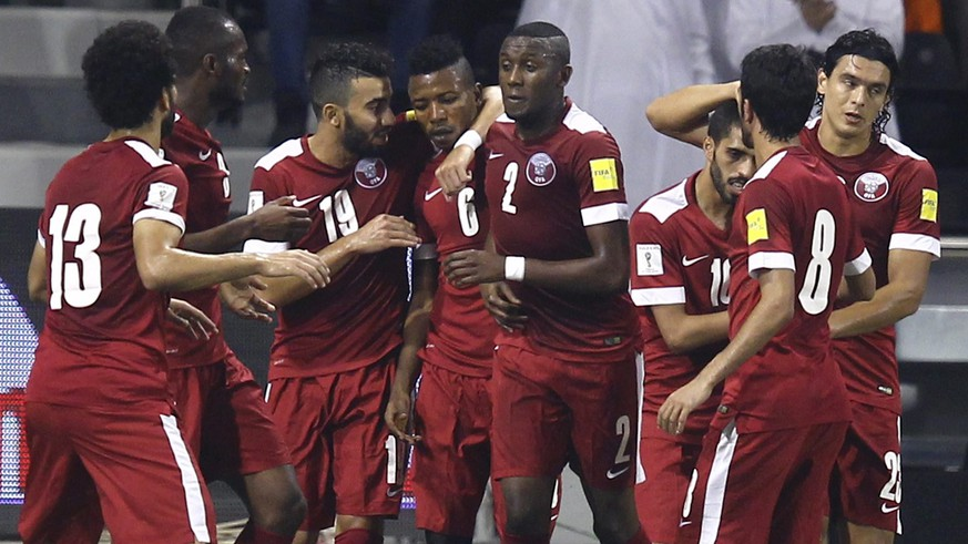 Qatar's soccer team players celebrate after their teammate Karim Boudiaf (not pictured) scores a goal against China during their 2018 World Cup qualifying soccer match in Doha, Qatar, October 8, 2015. REUTERS/Ibrahem Alomari