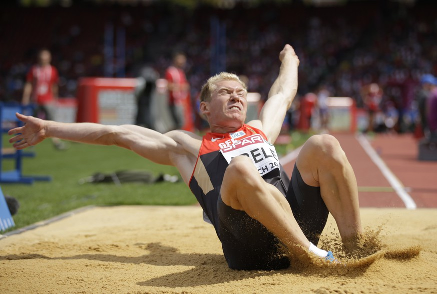 Germany's Arthur Abele makes an attempt in the long jump of the men's decathlon during the European Athletics Championships in Zurich, Switzerland, Tuesday, Aug. 12, 2014. (AP Photo/Matt Dunham)