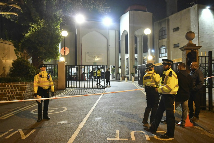 Police stage outside the London Central Mosque, near Regent's Park, in London, after a man was found with stab injuries in a nearby street, late Thursday, March 28, 2019. (Dominic Lipinski/PA via AP)