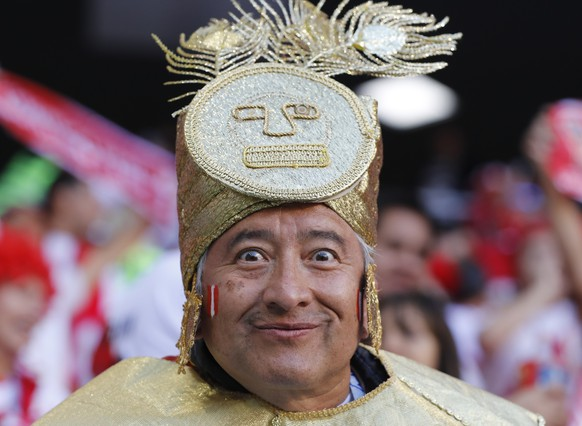 A Peru national team's fan poses for a photo prior to the group C match between Peru and Denmark at the 2018 soccer World Cup in the Mordovia Arena in Saransk, Russia, Saturday, June 16, 2018. (AP Photo/Efrem Lukatsky)