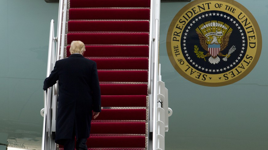President Donald Trump walks up the stairs of Air Force One before departure from Andrews Air Force Base, Md., Monday, March 20, 2017, en route to Louisville, Ky., for a rally. F.B.I. Director James Comey said Monday the F.B.I. had
