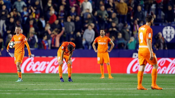 epa06680517 Malaga players react after being defeated at the end of the Spanish Primera Division soccer match between Levante and Malaga played at Ciudat de Valencia stadium in Valencia, Spain, 19 April 2018. After this score, Malaga will play next season on the Second Division.  EPA/KAI FORSTERLING