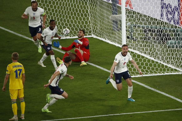 England's Jordan Henderson, right, celebrates after scoring his side's fourth goal during the Euro 2020 soccer championship quarterfinal match between Ukraine and England at the Olympic stadium in Rome, Italy, Saturday, July 3, 2021. (Alessandro Garofalo/Pool Via AP)