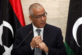 epa04115786 Libyan Prime Minister Ali Zeidan speaks during a press conference in Tripoli, Libya on 08 March 2014. Federalists in eastern Libya said 08 March that they have started to export oil independently of the central government, escalating their stand-off with Tripoli. Rebels have been blocking the oil ports in eastern Libya since July, siding with federalists calling for autonomy for the eastern region of Barqa, or Cyrenaica, who demand that oil revenues be assigned to the area. Pro-autonomy rebels held a ceremony to celebrate their first oil shipment. The government's National Oil company said a ship flying the North Korean flag docked in the port of Sidra, protected by armed groups who control the area. Prime Minister Ali Zeidan in a press conference threatened to strike any ship carrying oil from eastern Libya.  EPA/STR
