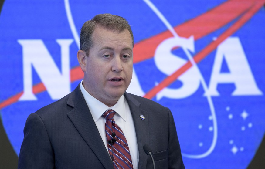 In this image provided by NASA, NASA Chief Financial Officer Jeff DeWit speaks during a news conference Friday, June 7, 2019, in New York. NASA announced Friday that it will open the International Space Station to private astronauts, with the first visit as early as next year. The round-trip ticket will cost an estimated $58 million. And accommodations aboard the orbiting outpost will run about $35,000 per night, for trips of up to 30 days long. (Bill Ingalls/NASA via AP