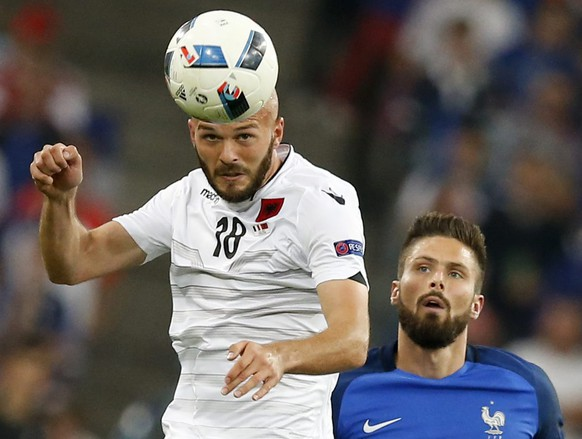 epa05368111 Arlind Ajeti (L) of Albania and Olivier Giroud of France in action during the UEFA EURO 2016 group A preliminary round match between France and Albania at Stade Velodrome in Marseille, France, 15 June 2016.(RESTRICTIONS APPLY: For editorial news reporting purposes only. Not used for commercial or marketing purposes without prior written approval of UEFA. Images must appear as still images and must not emulate match action video footage. Photographs published in online publications (whether via the Internet or otherwise) shall have an interval of at least 20 seconds between the posting.)  EPA/GUILLAUME HORCAJUELO   EDITORIAL USE ONLY