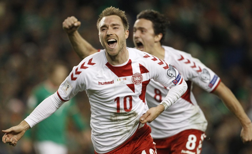 Denmark's Christian Eriksen celebrates after scoring his side's third goal during the World Cup qualifying play off second leg soccer match between Ireland and Denmark at the Aviva Stadium in Dublin, Ireland, Tuesday, Nov. 14, 2017. (AP Photo/Peter Morrison)