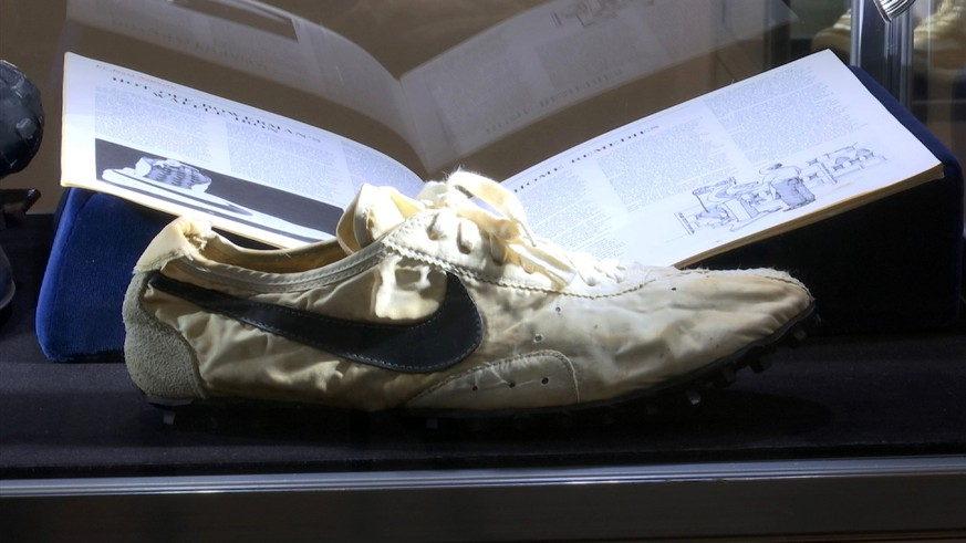 This image taken from video shows the Nike handmade Moon Shoe, designed by Nike co-founder Bill Bowerman in 1972, on display in New York on Friday, July 12, 2019. The sneaker is among 100 pairs of rare sneakers up for auction at Sotheby's in New York. Bidding runs through July 23. (AP Photo/Ted Shaffrey)