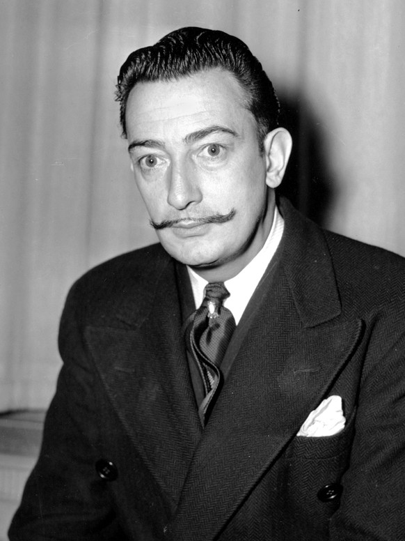 FILE - In this file photo taken on Nov. 4, 1942 Spanish surrealist painter, Salvador Dali is pictured in New York. A Spanish judge on Monday June 26, 2017, has ordered the remains of artist Salvador Dali to be exhumed following a paternity suit by a woman named by Europa Press agency as Pilar Abel, 61 from the nearby city of Girona. Dali, considered one of the fathers of surrealism in art, died in 1989 and is buried in his museum in the northeastern town of Figueres. (AP Photo, File)