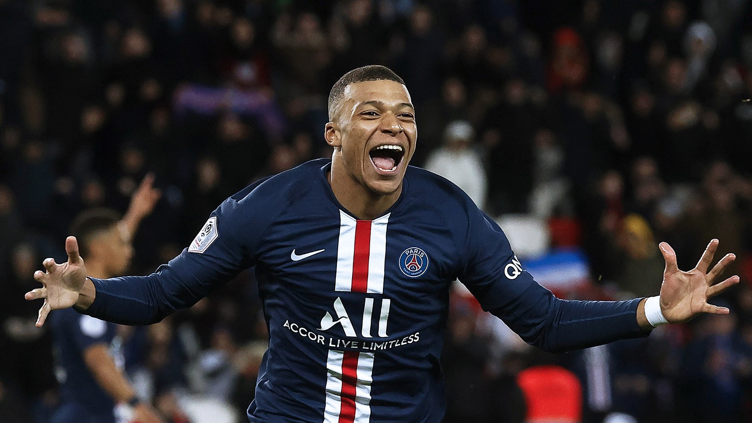 epa08260092 Paris Saint-Germain's Kylian Mbappe celebrates after scoring the 4-0 lead during the French Ligue 1 soccer match between Paris Saint-Germain (PSG) and Dijon FCO at the Parc des Princes stadium in Paris, France, 29 February 2020.  EPA/YOAN VALAT