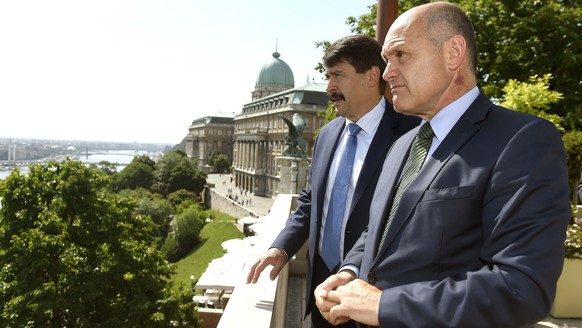 President of the Austrian National Council, the first chamber of the country's Parliament Wolfgang Sobotka, right, is shown the panorama by Hungarian President Janos Ader, left, from the terrace of the presidential Alexander Palace in Budapest, Hungary, Thursday, May 24, 2018. (Noemi Bruzak/MTI via AP)