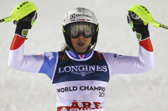 Switzerland's Wendy Holdener celebrates after winning the women's combined, at the alpine ski World Championships in Are, Sweden, Friday, Feb. 8, 2019. (AP Photo/Alessandro Trovati)