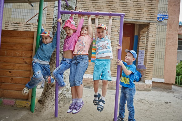 Children play outdoors on recreation equipment, at the 'Katusha' kindergarten in the city of Kramatorsk in Donetsk Region. UNICEF, with support from the Government of Japan, has procured school furniture, sports equipment, bed clothes and other items for the kindergarten, which was shelled twice within eight months in 2014 during the hostilities. Windows were blown out and walls and roofs were damaged as a result of the shelling, causing the kindergarten to close temporarily. The school has since been partially repaired. UNICEF has also provided essential hygiene and education supplies for the kindergarten, with support from the European Union and other donors and, with partners, is also supporting psychosocial activities and training for the students and their parents and teachers to address their traumatic experience. An estimated 25 of its 227 students attending the kindergarten are internally displaced.