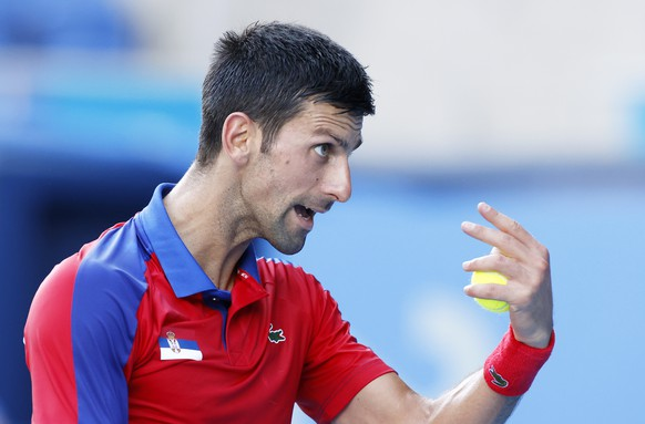 epa09381735 Novak Djokovic of Serbia reacts during the Men's singles Bronze medal match against Pablo Carreno Busta of Spain during the Tennis events of the Tokyo 2020 Olympic Games at the Ariake Coliseum in Tokyo, Japan, 31 July 2021.  EPA/RUNGROJ YONGRIT