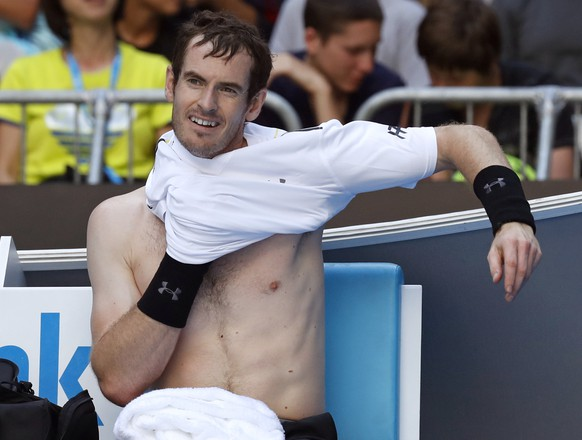 Britain's Andy Murray changes his shirt during a break while playing United States' Sam Querrey in their third round match at the Australian Open tennis championships in Melbourne, Australia, Friday, Jan. 20, 2017. (AP Photo/Kin Cheung)
