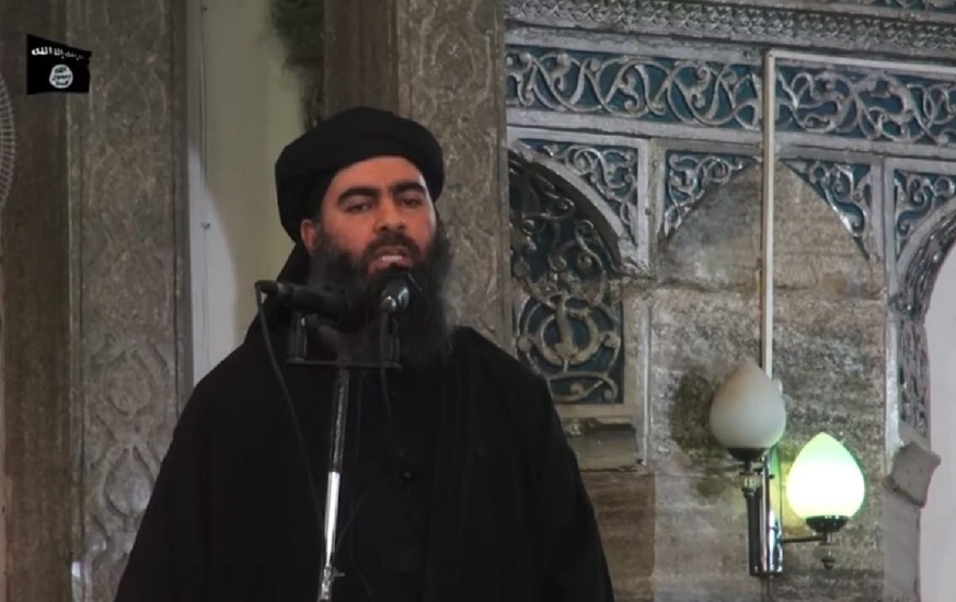 epa04300525 A photograph made from a video released on 05 July 2014 by the jihadist affiliated group Furqan Media via their twitter account allegedly showing Islamic State (IS) leader Abu Bakr al-Baghdadi delivering a sermon during Friday prayers at a mosque in Mosul, Iraq, 04 July 2014. Abu Bakr al-Baghdadi, the ruler of the self-styled caliphate recently proclaimed by the jihadist Islamic State in Iraq and the Levant (ISIL), appears in a video said to be filmed inside a mosque in Mosul where he is delivering a sermon.  Abu Bakr al-Baghdadi declared an Islamist caliphate in the territory under the group's control in Iraq and Syria earlier this week.  EPA/FURQAN MEDIA / HANDOUT BEST QUALITY AVAILABLE. EPA IS USING AN IMAGE FROM AN ALTERNATIVE SOURCE AND CANNOT PROVIDE CONFIRMATION OF CONTENT, AUTHENTICITY, PLACE, DATE AND SOURCE. HANDOUT EDITORIAL USE ONLY/NO SALES