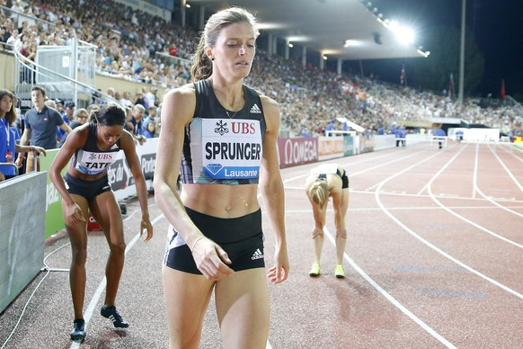 Lea Sprunger from Switzerland reacts after the women's 400m hurdles race at the Athletissima IAAF Diamond League international athletics meeting in the Stade Olympique de la Pontaise in Lausanne, Switzerland, Thursday, August 25, 2016. (KEYSTONE/Valentin Flauraud)