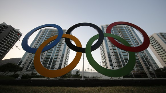 FILE - In this July 23, 2016, file photo, a representation of the Olympic rings are displayed in the Olympic Village in Rio de Janeiro, Brazil. The United States Olympic and Paralympic Committee took steps designed to help athletes in the wake of Olympic sex-abuse scandals, proposing an increase in their numbers on its board and recasting its mission statement to include the job of promoting their well-being. These changes are part of a proposal, released Monday, Aug. 19, 2019, to rewrite the USOPC bylaws. (AP Photo/Leo Correa, File)
