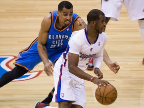 Thabo Sefolosha (L) of the Oklahoma City Thunder guards Chris Paul of the Los Angeles Clippers during game 4 of their NBA playoff series, May 11, 2014, at Staples Center in Los Angeles, California.  The Clippers defeated the Thunder 101-99.  AFP PHOTO / ROBYN BECK