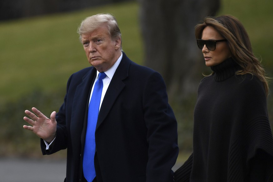 President Donald Trump and first lady Melania Trump walk to Marine One on the South Lawn of the White House in Washington, Friday, Feb. 15, 2019, for the short trip to Andrews Air Force Base, Maryland. The Trumps are heading to their Mar-a-Lago estate in Florida for the long weekend. (AP Photo/Susan Walsh)