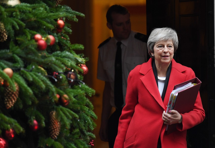 epa07209581 British Prime Minister Theresa May departs 10 Downing Street in London, Britain, 05 December  2018. Prime Minister Theresa May is holding five days of debate over Brexit at parliament hoping to persuade MPs to vote for her deal.  EPA/ANDY RAIN