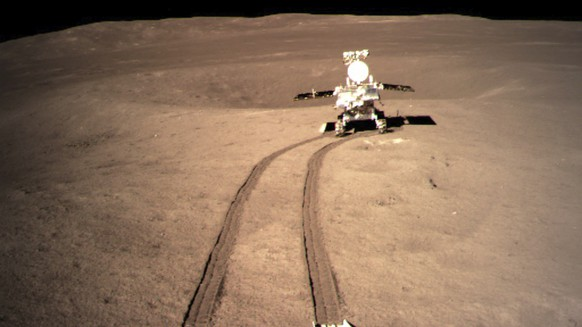 In this file photo provided on Jan. 4, 2019, by China National Space Administration via Xinhua News Agency, Yutu-2, China's lunar rover, leaves wheel marks after leaving the lander that touched down on the surface of the far side of the moon. China's space agency says that all systems are go for its spacecraft and rover that have made a pioneering landing on the far side of the moon. (China National Space Administration/Xinhua News Agency via AP, File)
