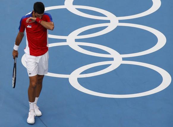 epa09379054 Novak Djokovic of Serbia reacts during the Men's Singles Semifinal Tennis events of the Tokyo 2020 Olympic Games at the Ariake Coliseum in? Tokyo, Japan, 30 July 2021.  EPA/RUNGROJ YONGRIT