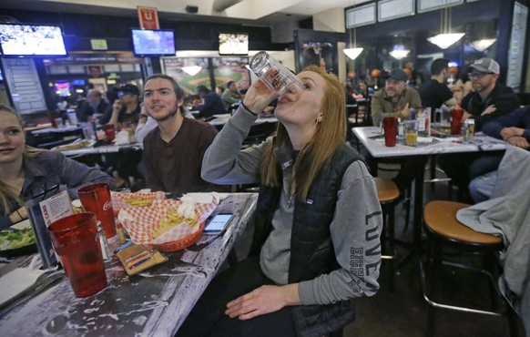 Utah Jazz fan Abigail Roberson drinks a beer while watching a Jazz Warriors game at Legends Sports Grill in Salt Lake City Tuesday, May 2, 2017. Salt Lake City leaders and tourism officials playfully jabbed back at Golden State Warriors players who bemoaned the lack of nightlife in Utah, hoping to combat the predominantly Mormon state's reputation as a boring place where it's tough to get a drink. The tourism agency in the state capital launched a new website and video Monday titled,