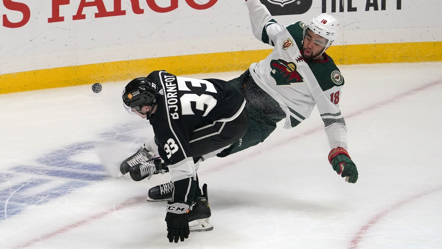 Los Angeles Kings defenseman Tobias Bjornfot, left, and Minnesota Wild left wing Jordan Greenway fall to the ice during the second period of an NHL hockey game Tuesday, Feb. 16, 2021, in Los Angeles. (AP Photo/Mark J. Terrill) Tobias Bjornfot,Jordan Greenway