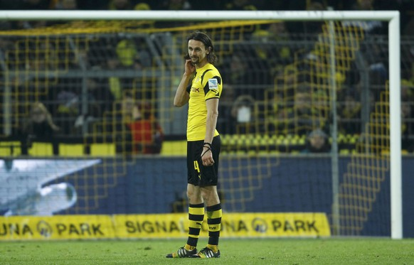 Borussia Dortmund's Neven Subotic reacts following his team's defeat by FC Augsburg in their German first division Bundesliga soccer match in Dortmund February 4, 2015.         REUTERS/Ina Fassbender (GERMANY  - Tags: SPORT SOCCER) DFL RULES TO LIMIT THE ONLINE USAGE DURING MATCH TIME TO 15 PICTURES PER GAME. IMAGE SEQUENCES TO SIMULATE VIDEO IS NOT ALLOWED AT ANY TIME. FOR FURTHER QUERIES PLEASE CONTACT DFL DIRECTLY AT + 49 69 650050.