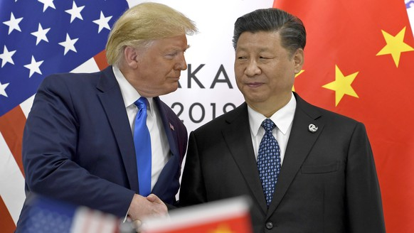 FILE - In this June 29, 2019, file photo, U.S. President Donald Trump, left, shakes hands with Chinese President Xi Jinping during a meeting of the G-20 summit in Osaka, western Japan. Although President Donald Trump has ordered U.S. companies to stop dealing with China, small business owners say complying would hurt, even devastate, their companies. Businesses that have already lost revenue or profits to Trump's tariffs on imports from China and that country's retaliatory duties say they can't easily find alternatives in other countries. (AP Photo/Susan Walsh, File) Donald Trump,Xi Jinping