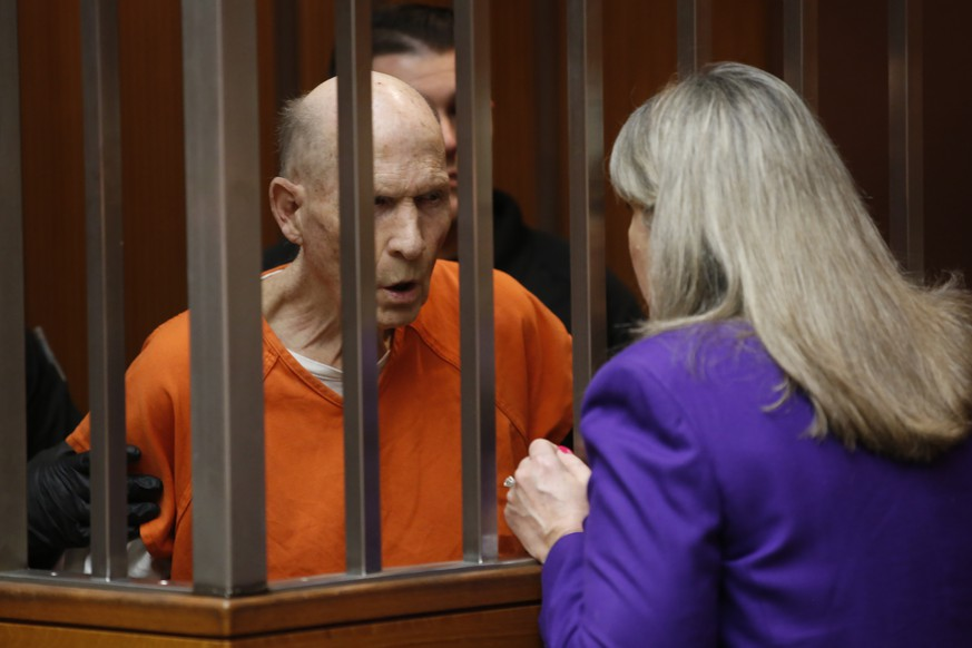 Joseph James DeAngelo, charged with being the Golden State Killer, talks with his attorney, Diane Howard, during his appearance in Sacramento County Superior Court in Sacramento, Calif., Thursday, March 12, 2020. Superior Court Judge Steve White approved prosecutors' request to take more DNA samples from DeAngelo over the objections of his defense attorneys. (AP Photo/Rich Pedroncelli) Joseph James DeAngelo,Diane Howard