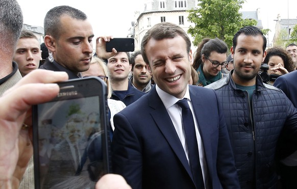 epa06897630 (FILE) - The then French presidential candidate Emmanuel Macron (C) of the 'En Marche' political movement flanked by security staff Alexandre Benalla (R) during an election campaign visit in Rodez, France, 05 May 2017 (reissued 19 July 2018). A video has been released on 19 July 2018 showing Alexandre Benalla, French President Emmanuel Macron's deputy chief of staff, wearing a riot helmet and police uniform, allegedly attacking protesters during street demonstrations on 01 May 2018.  EPA/GUILLAUME HORCAJUELO