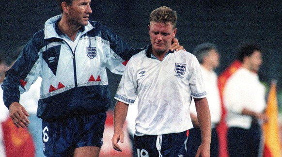 The July 4, 1990 photo shows England's Paul Gascoigne crying as he is escorted off the field by team captain Terry Butcher, after his England lost a penalty shoot-out in the semi-final match of the World Cup against West Germany in Turin, Italy. Another Germany vs. England match at the World Cup brings back memories of classic moments that include a disputed goal in the final, the English losing a 2-0 lead, and a dramatic shootout win for the Germanys. The two teams meet in the last 16 on Sunday and could well write another chapter in one of soccer's most famous rivalries.  (AP Photo/Roberto Pfeil)