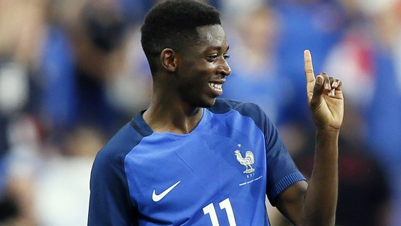 France's Ousmane Dembele reacts after scoring his side's 3rd goal during a friendly soccer match between France and England at the Stade de France in Saint Denis, north of Paris, France, Tuesday, June 13, 2017. (AP Photo/Francois Mori)