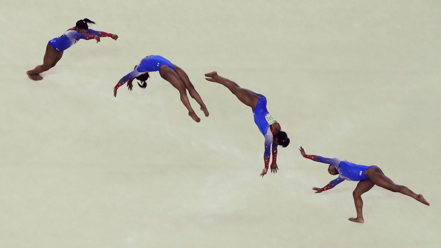 In this multiple exposure photo, United States' Simone Biles performs on the floor during the artistic gymnastics women's apparatus final at the 2016 Summer Olympics in Rio de Janeiro, Brazil, Tuesday, Aug. 16, 2016. (AP Photo/Julio Cortez)