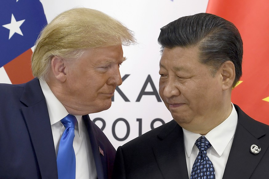 President Donald Trump, left, meets with Chinese President Xi Jinping during a meeting on the sidelines of the G-20 summit in Osaka, Japan, Saturday, June 29, 2019. (AP Photo/Susan Walsh) Donald Trump,Xi Jinping