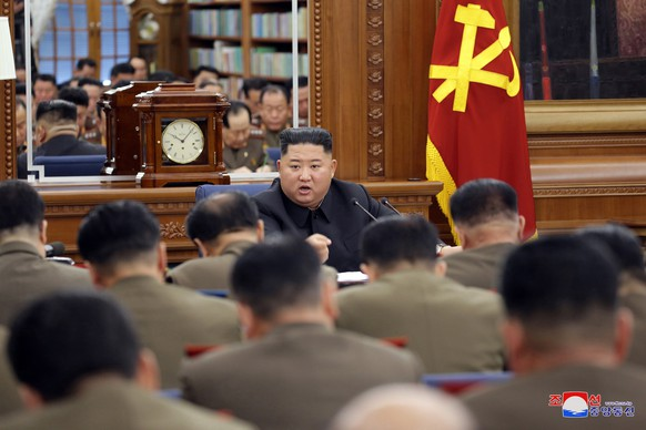 epa08086247 An undated photo released by the official North Korean Central News Agency (KCNA) on 22 December 2019 shows North Korean leader Kim Jong-un (C) chairing the Third Enlarged Meeting of the Seventh Central Military Commission of the Workers' Party of Korea in Pyongyang, North Korea (issued 22 December 2019). According to local media reports, the meeting was held to discuss boosting Pyongyang's military capability, at a time of rising tension with the United States.  EPA/KCNA   EDITORIAL USE ONLY
