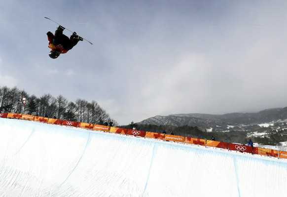Patrick Burgener, of Switzerland, jumps during the men's halfpipe qualifying at Phoenix Snow Park at the 2018 Winter Olympics in Pyeongchang, South Korea, Tuesday, Feb. 13, 2018. (AP Photo/Gregory Bull)